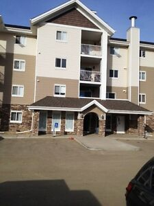 Beautiful condo in Sylvan Lake with balcony, laundry + lots more
