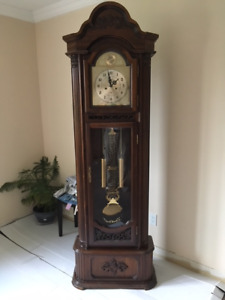 A Solid wood standing clock