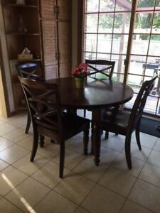 Dining table with 4 chairs and buffet with hutch.
