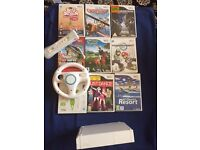 Wii Console with Wii Fit Board And Games Bundle
