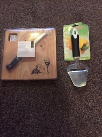 wooden cheese board with knife and cheese planer