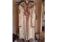 Men's cream, gold & red sharwani suit