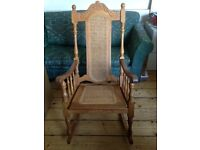 Pine rocking chair with hand carved decorative back