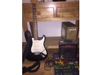 Black electric guitar with amp made by Encore.