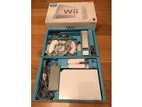 Nintendo Wii with Wii Sports, 2 nunchucks & 2 remotes