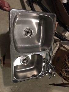 Stainless steel kitchen sink and half with moen faucets