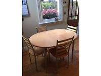 Free extending dining table when you purchase 6 chairs in beech and chrome
