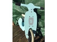 Blue toddler balance bike with soft seat cover