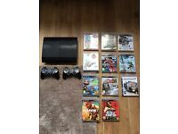 Playstation 3 500GB Super Slim, 2 Official Controllers, 11 Top Games