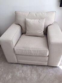 Large oatmeal coloured armchair