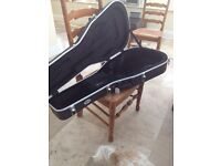 Black hard cover acoustic guitar case TGI