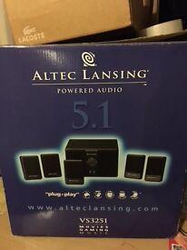 Alter Lansing 5.1 surround sound and speaker set.