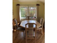 Extendable solid oak dining table and 6 chairs