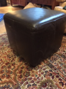 Black leather ottoman - $100