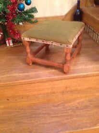 Green drape wooden foot stool