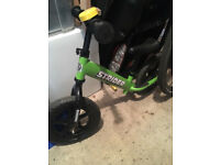two green balance bike