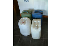 Four off -- Five Gallon Plastic Containers all with Caps the two white ones are food quality