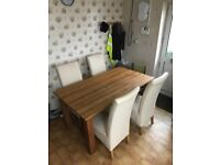 For sale, an oak table and four chairs