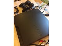 PS3 Slimline Console with 2 Controllers in Good Working Order