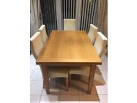 Light Oak dining table and 5 chairs plus matching Oak sideboard
