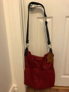 HIDES IN HAND  PURSE  MADE IN CANADA