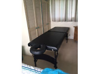 Massage table with headrest