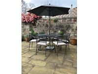 Garden table and chairs with cushions, parasol and base - £100