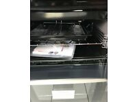 cannon double oven , 4 rings gas cooker with electric ignition; Black with glass splash back cover