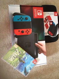 BRAND NEW - Nintendo Switch - Neon Red/Neon Blue with Delux Travel Case & The Legend of Zelda Game