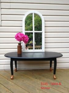 Vintage coffee table and antiqued chapel mirror