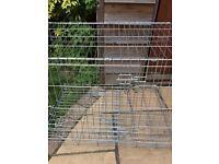 Medium sized wire metal double door dog training crate