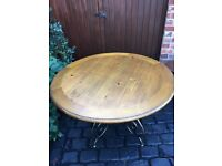 kitchen table and 4 chairs in oak excellent condition metal frame and wooden top,country style