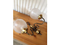 Four pairs of wall lights, brass and glass. Free for collection.