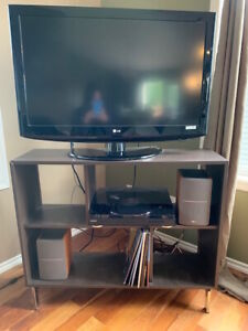 Brown TV stand with metal legs