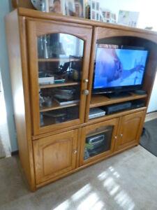 Oak entertainment unit with curio cabinet.