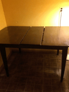 Wood dining room table.   $100.00  OBO
