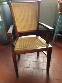 8 lovely dining chairs, dark wood with wicker seats and backs. Includes 2 carver chairs with arms.