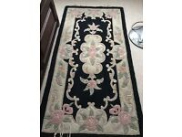 Black and pastel colour chinese carpets with embossed floral design used
