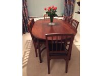 Mahogany dining table with matching 6 chairs
