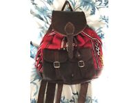 colourful vintage leather and fabric backpack bag
