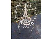 Ornate metal garden chairs