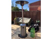 Stainless Steel Gas Patio Heater with 11 kg gas bottle and cover only used twice.