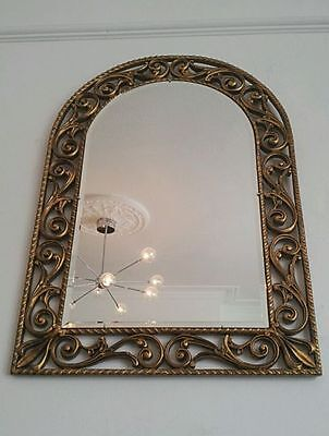 Gilt-framed vintage mirror
