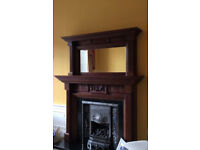 Wooden fireplace mantel top with mirror