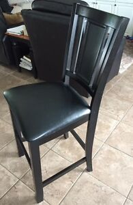4 Black leather and dark brown finish bar stools.