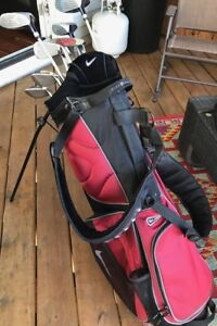Set of (left ) Memorial Ram golf clubs plus Nike bag