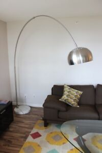 Arc lamp with brushed metal shade and marble base