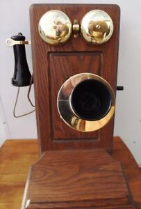 Vintage Wooden Wall Mount Reproduction 1900's phone.