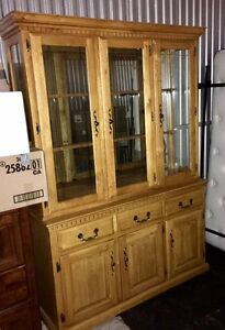 Oak Cabinet and Hutch with Oval Table and Chairs
