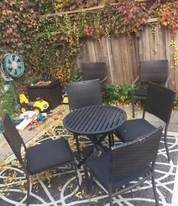 SMALL IRON TABLE AND 6 OUTDOOR DINING CHAIRS - $60 FOR THE SET